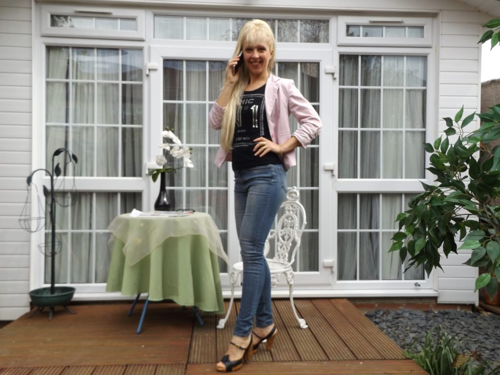 Casual look with jeans, blush pink blazer and a black informal tee. I recommend wearing high black heels or boots.